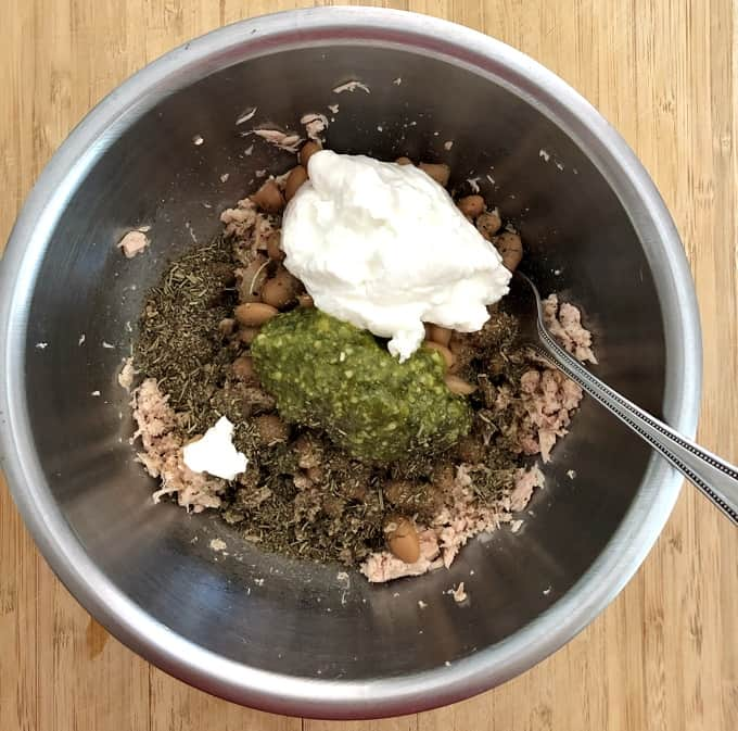 Canned tuna, white beans, Herbes de Provence, basil pesto and Greek yogurt in mixing bowl.