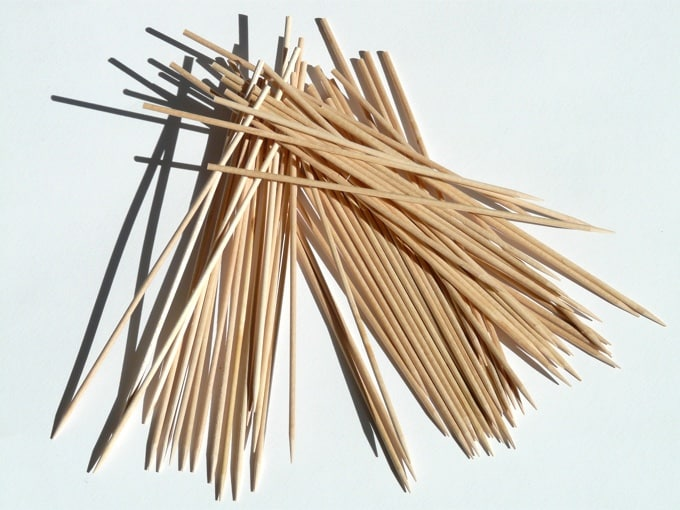 Wooden skewers on white background.