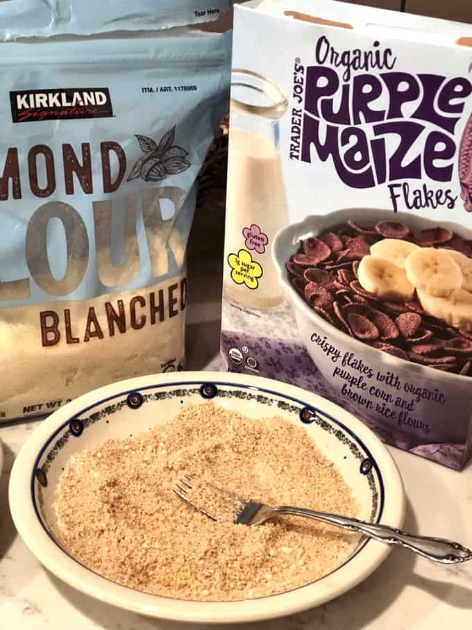 Almond flour and blue corn flakes for making crispy chicken tenders.