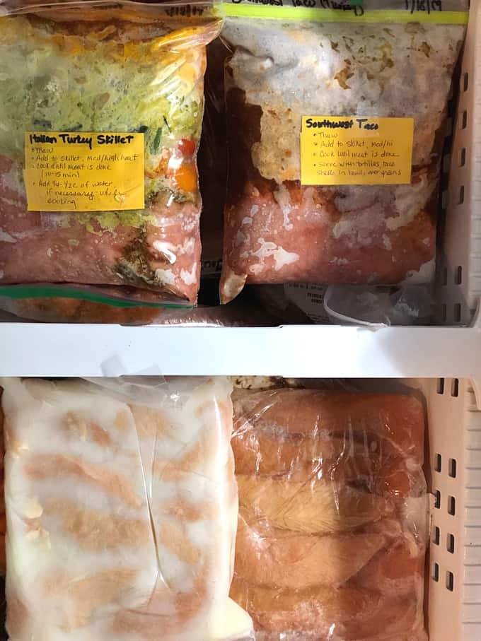 Freezer meals and bag with marinating pickle juice tenders.