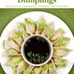 Vegetarian Chinese Dumplings on white serving plate with soy dipping sauce.