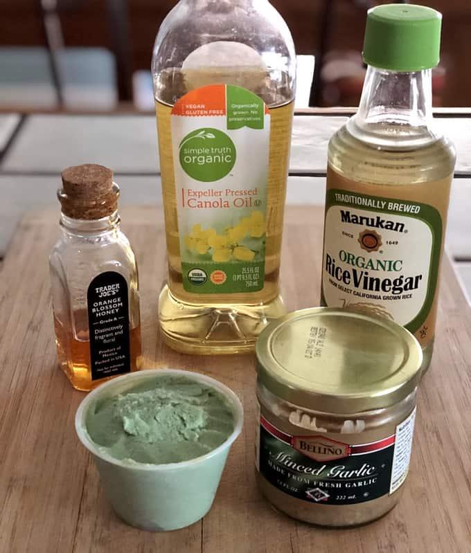 Honey, canola oil, rice vinegar, garlic and wasabi for making wasabi vinaigrette salad dressing.