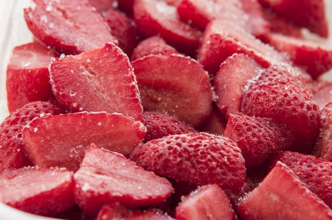 Chopped frozen strawberries up close.