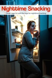 Woman standing at open refrigerator late at night snacking.
