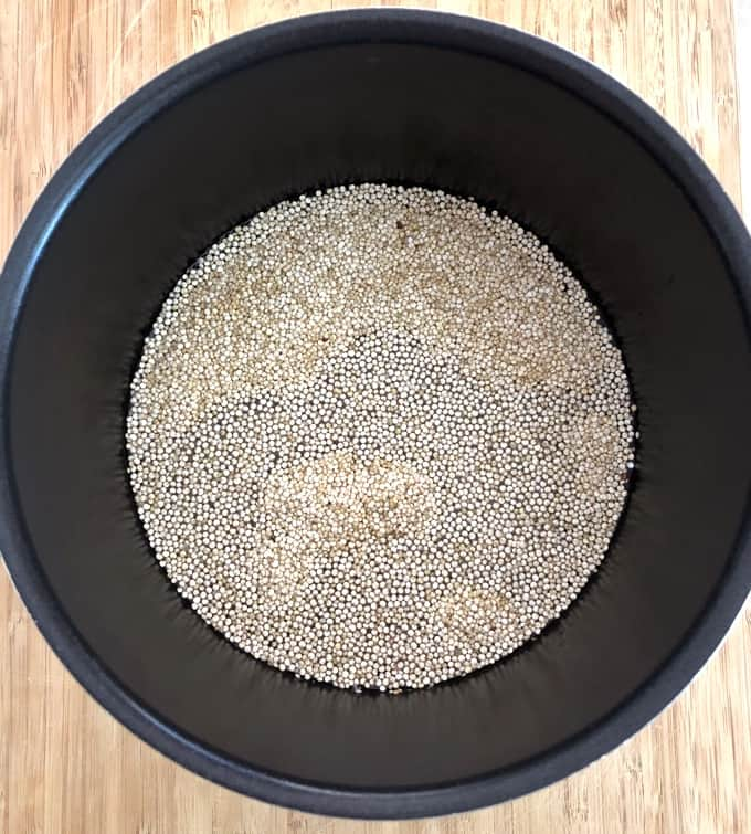 Quinoa and water in pot before cooking.