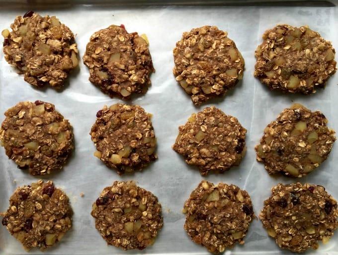 Breakfast oat cookies on parchment lined baking sheet.