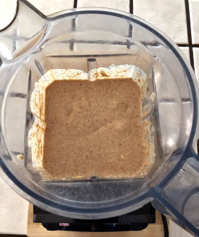 Looking down in Vitamix blender to see blended banana oat muffin batter.