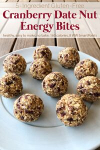 Cranberry Date Nut Energy Bites on blue plate on wood table.