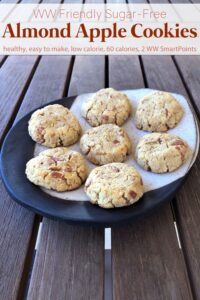 Sugar-free almond apple cookies on ceramic plate on wooden table.