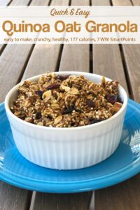 Quinoa oat granola in white ramekin on blue plate on wooden table.
