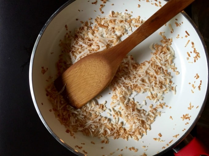 Toasting shredded coconut in skillet.