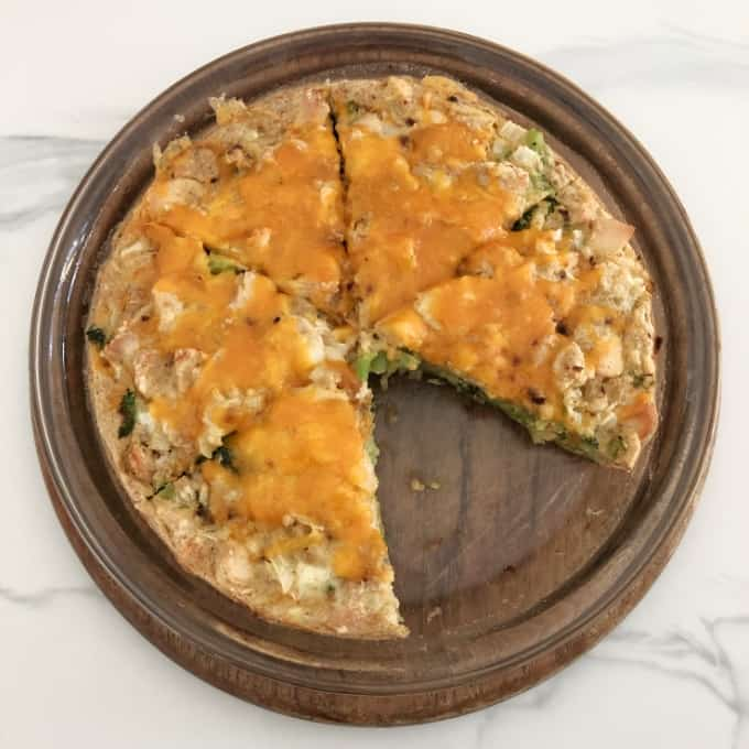 Impossible Cheddar Chicken Broccoli Pie cut into six slices in pie dish