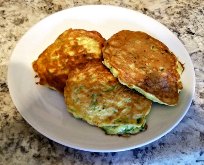 Plate of cooked zucchini pancakes.