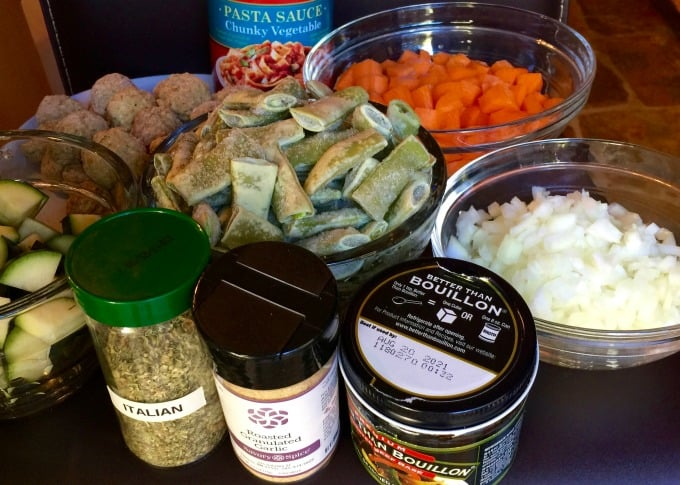 Frozen mini meatballs, pasta sauce, beef broth, chopped carrots, onions, frozen green beans, chopped zucchini, Italian seasoning and granulated garlic.