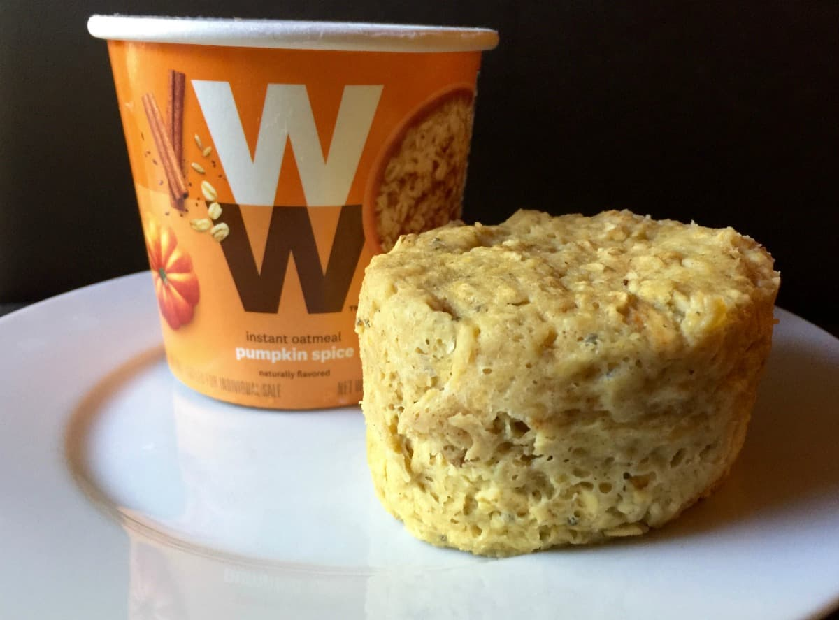 WW Pumpkin Spice instant oatmeal muffin cup on white plate.