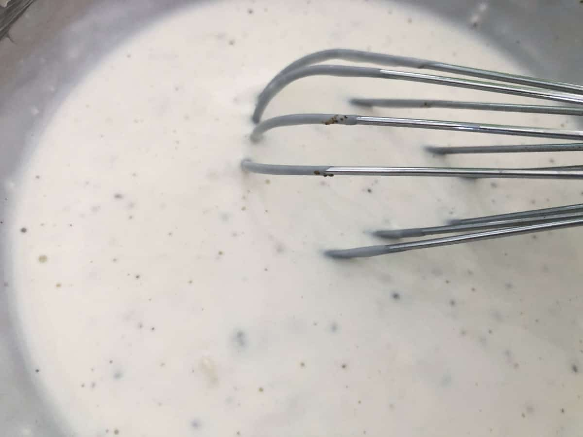 Whisking homemade blue cheese dressing.