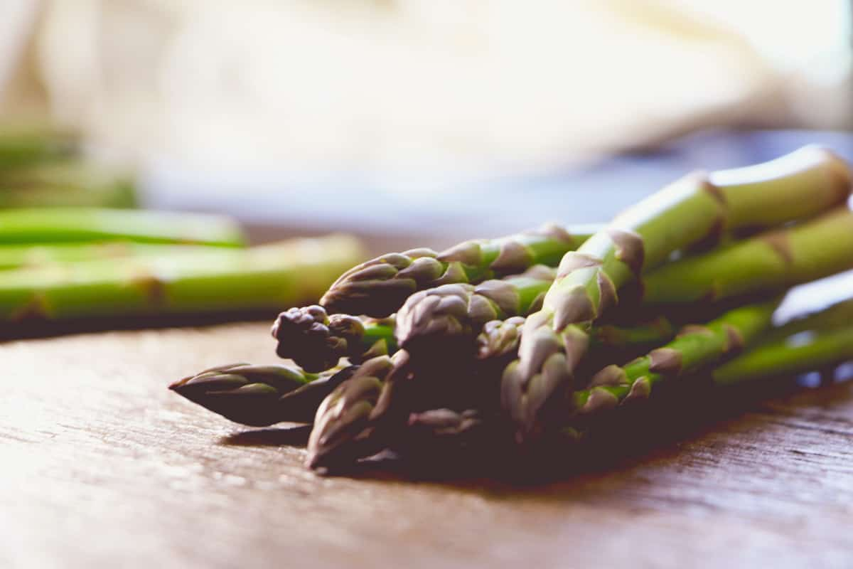 Fresh asparagus spears on counter