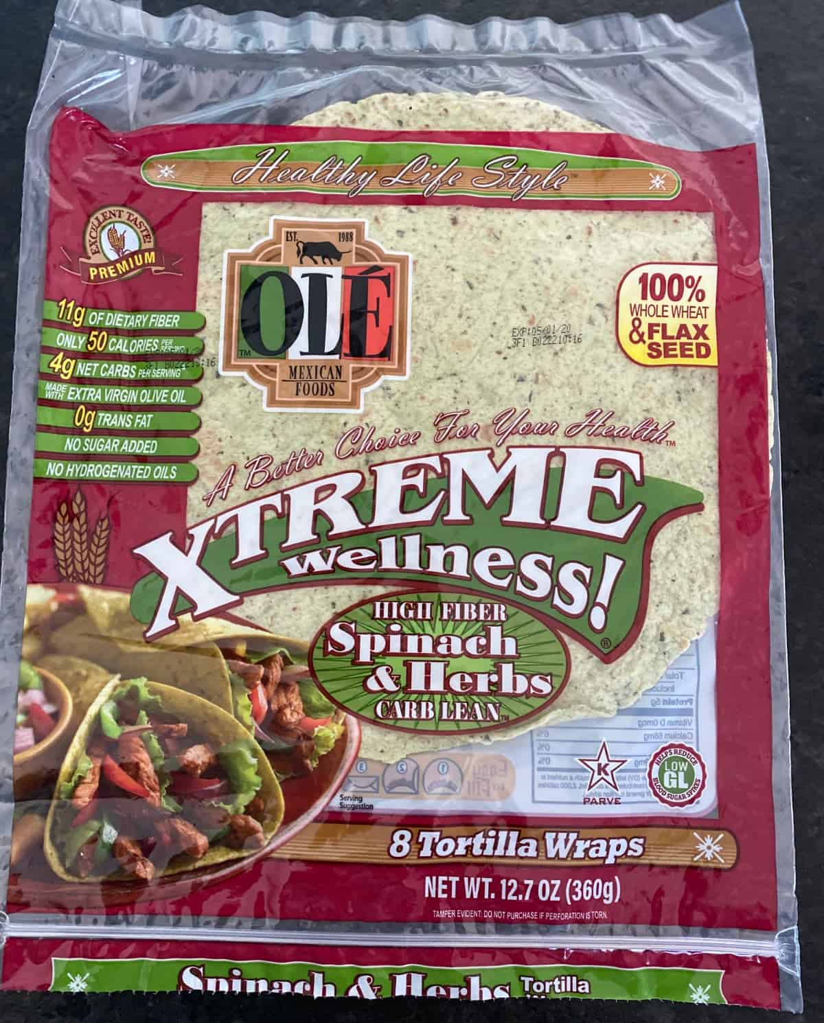 Package of Ole Xtreme Wellness brand spinach and herb tortillas.