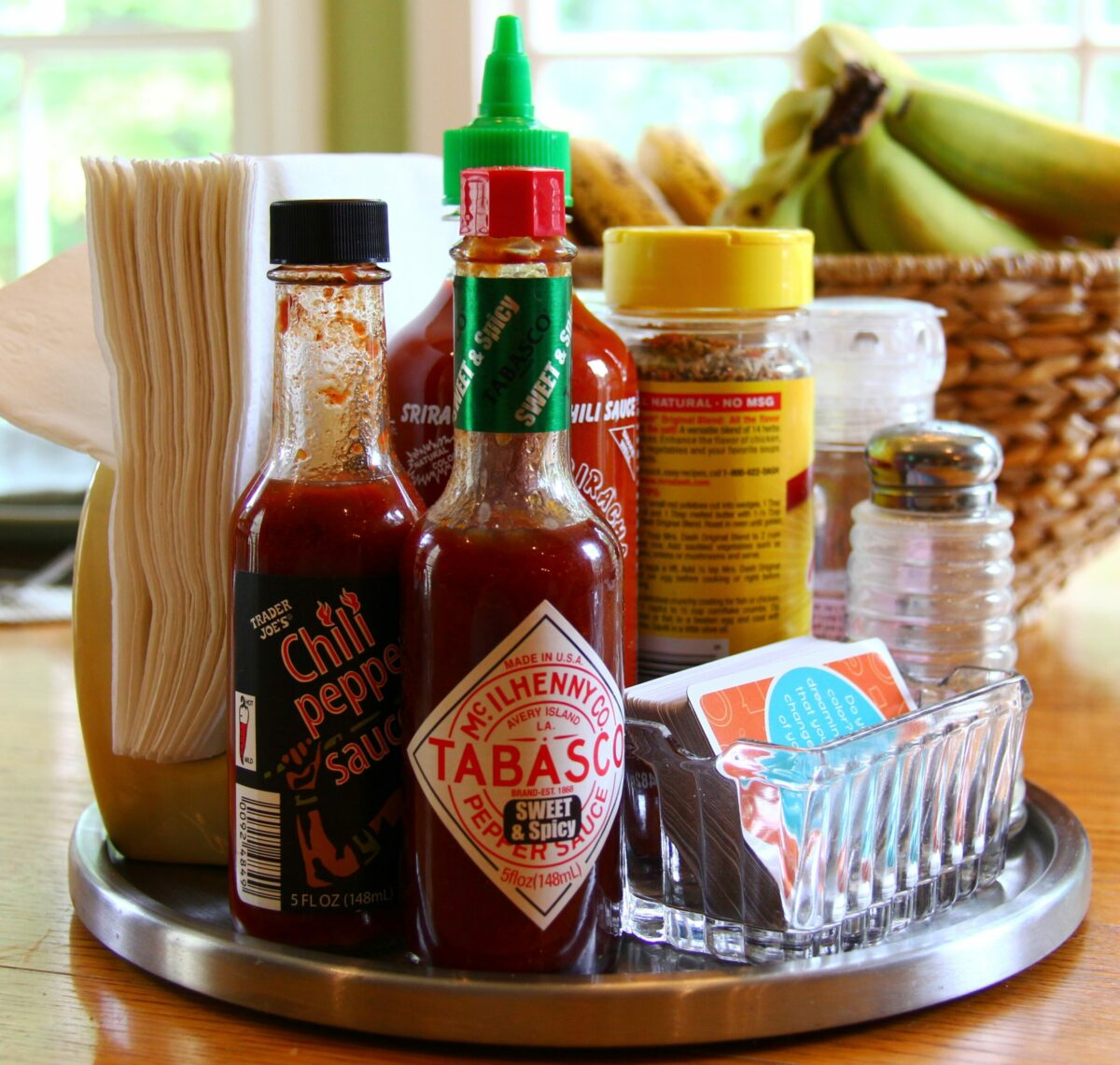 Lazy Susan with bottles of hot sauce and various spices.