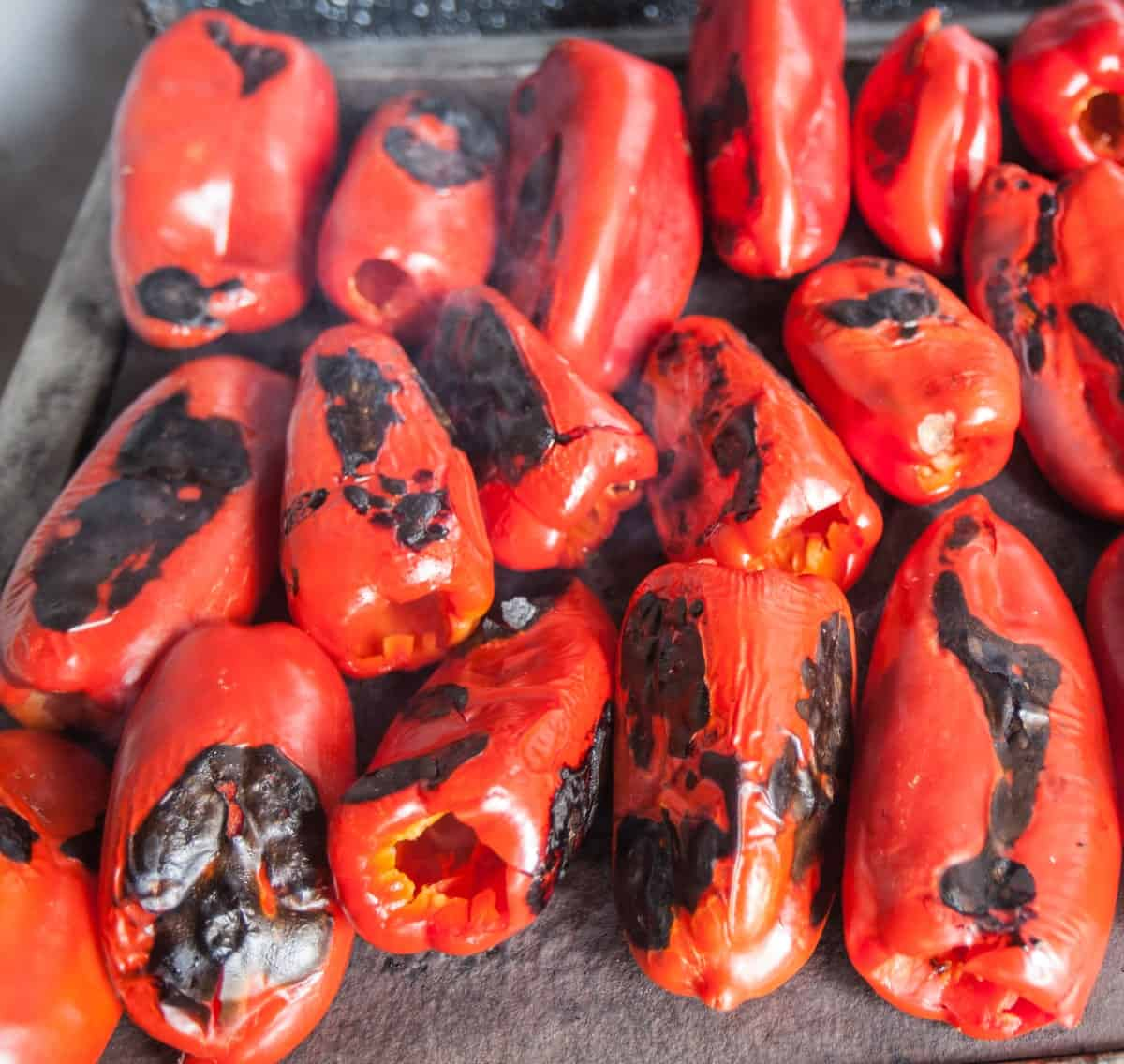 Roasting red peppers on pan.