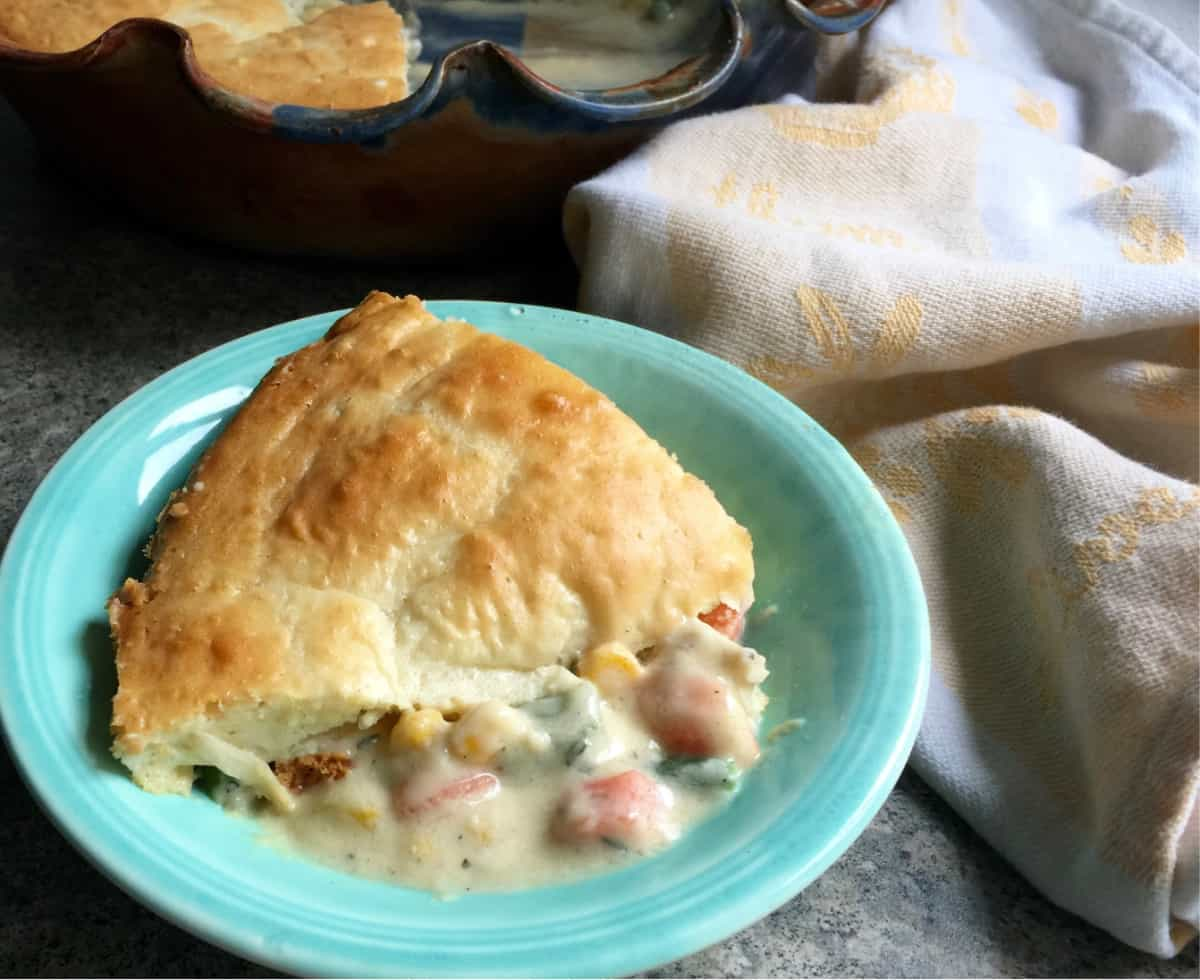 Piece of Impossibly Easy Chicken Pot Pie on small green plate.