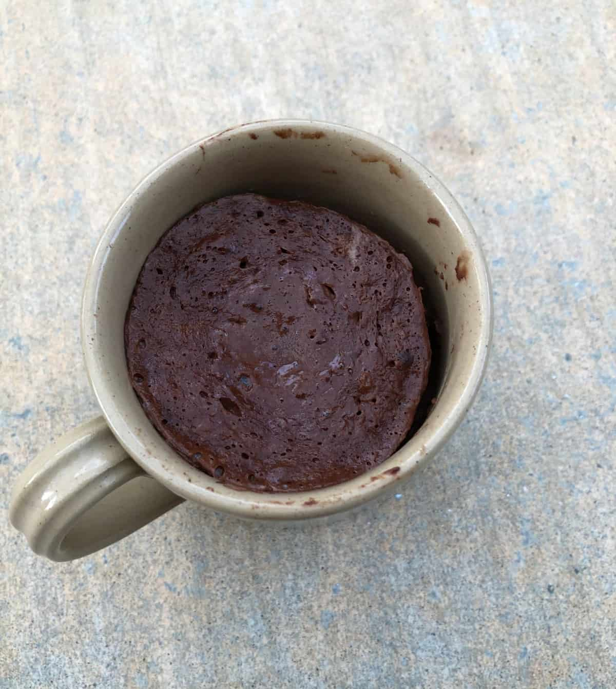 Banana Cocoa Pudding Cake in a mug from above.