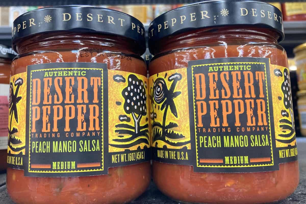 Two jars of peach mango salsa.