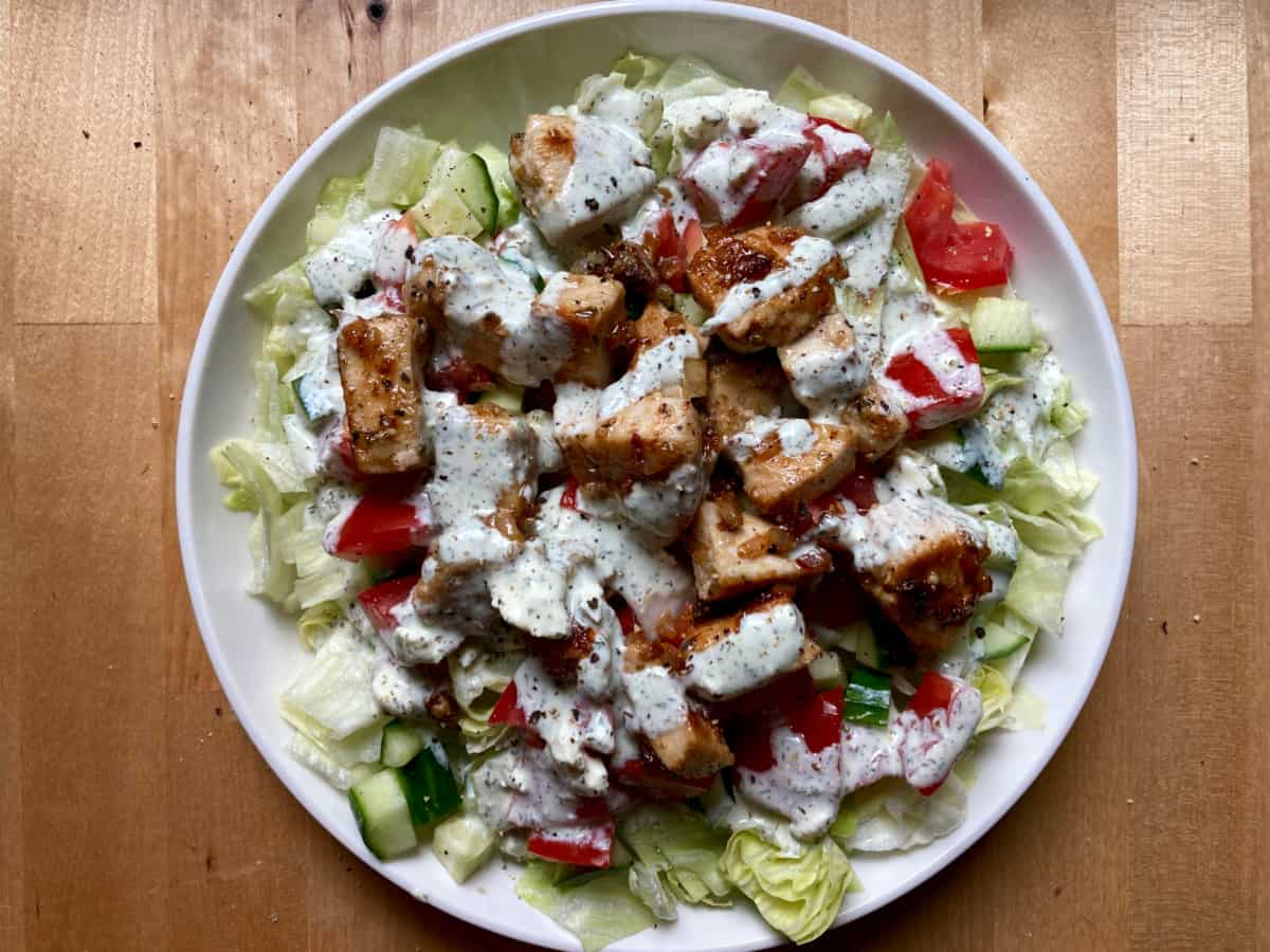 Chicken Souvlaki Salad on white plate from above.
