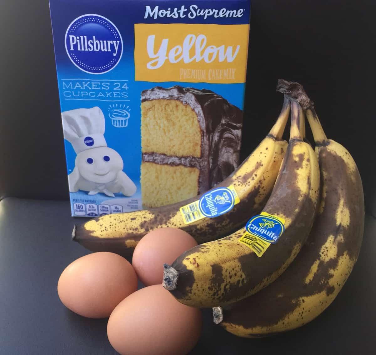 Box of yellow cake mix, eggs and overripe bananas.
