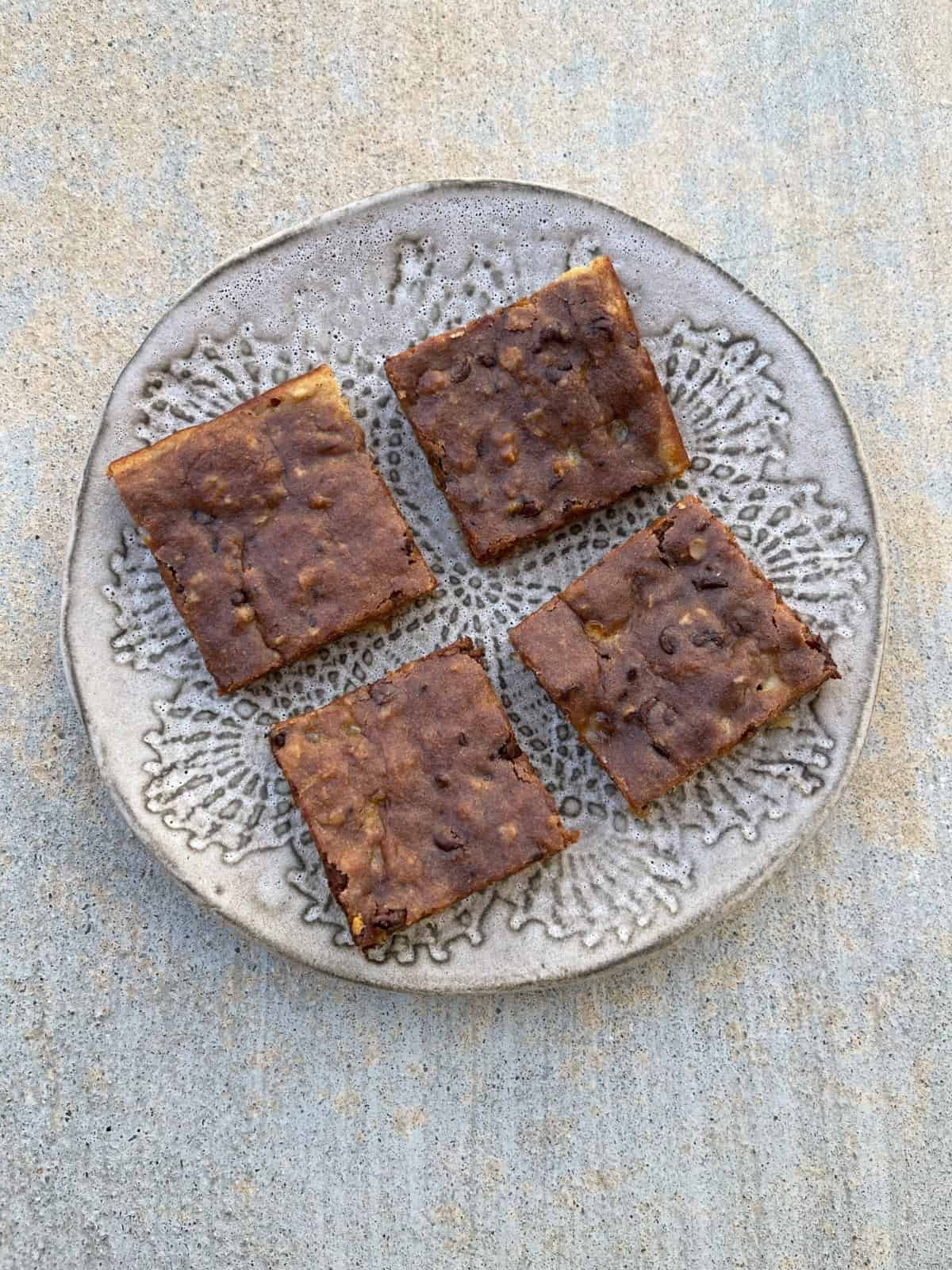 Banana Bread Brownies on ceramic plate from above.