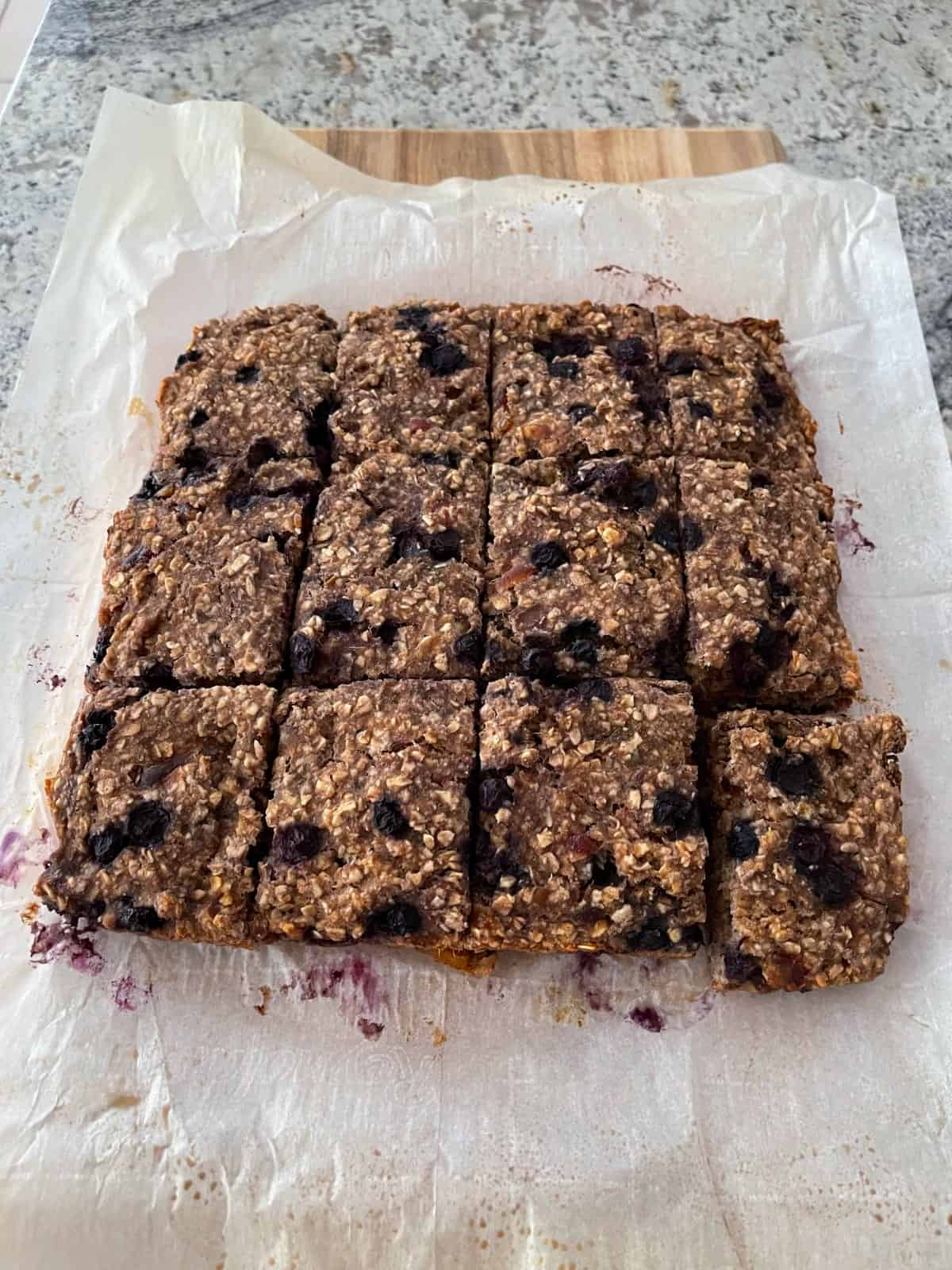 Blueberry banana oat squares on parchment paper.